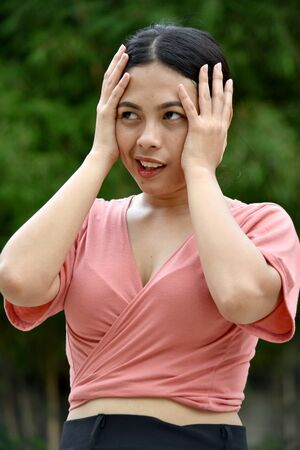 An Attractive Asian Woman Under Stress 写真素材 - 129897058