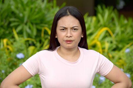 An Unemotional Youthful Asian Adult Female 版權商用圖片