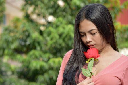 Unhappy Beautiful Filipina Adult Female With Flowers 版權商用圖片