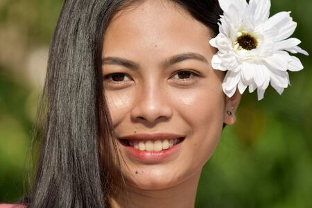 Smiling Youthful Asian Female With Flowers Фото со стока
