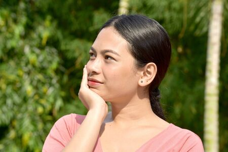 A Contemplative Pretty Filipina Person