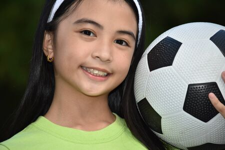 Sporty Asian Child Soccer Player Smiling With Soccer Ball Stockfoto