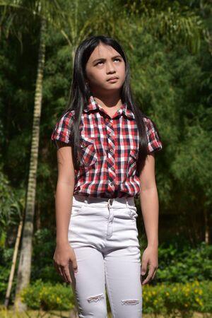 An Apathetic Youthful Asian Girl Preteen
