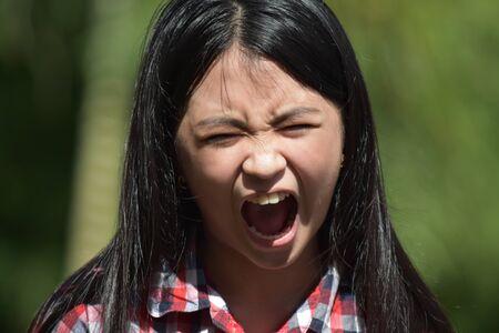 A Shouting Petite Diverse Girl Child