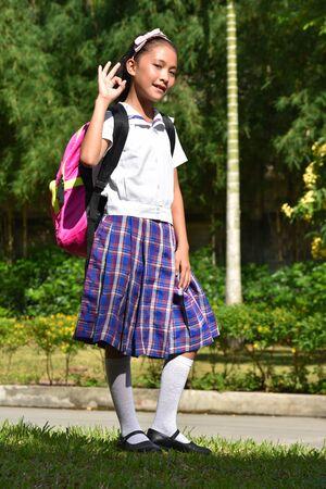 Okay Catholic Asian Girl Student Wearing School Uniform With Notebooks 写真素材