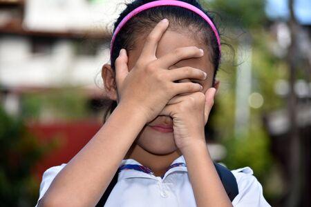 A Filipina Girl Student Under Stress 写真素材