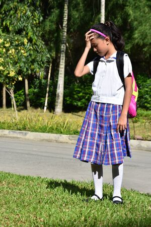 Catholic Minority Female Student Under Stress Wearing School Uniform 写真素材 - 129900880