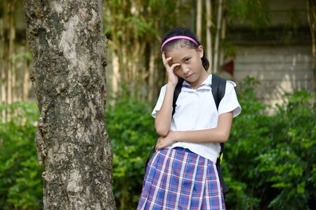 Wondering Asian Girl Student Wearing School Uniform With Notebooks Imagens