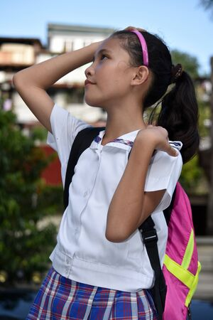 Prep Asian Female Student Wondering Wearing School Uniform With Notebooks
