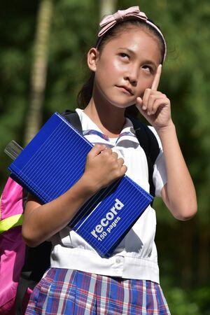 Thoughtful Catholic School Girl Wearing School Uniform With Notebooks