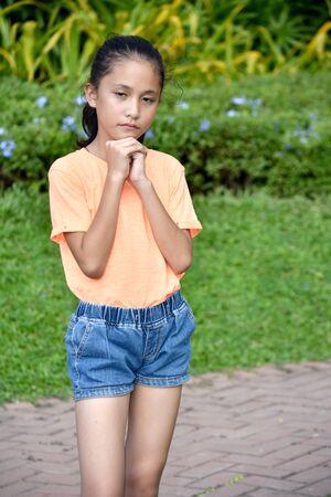 A Beautiful Teen Girl Praying