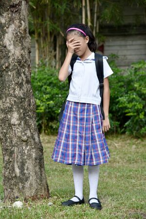 Young Filipina Female Student Under Stress Wearing Uniform With Notebooks