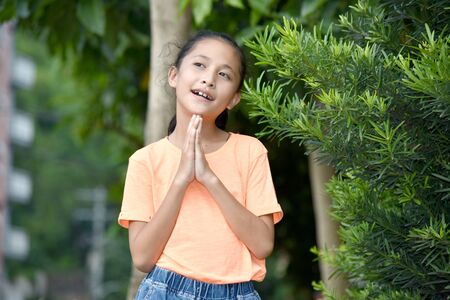 A Young Asian Female Praying