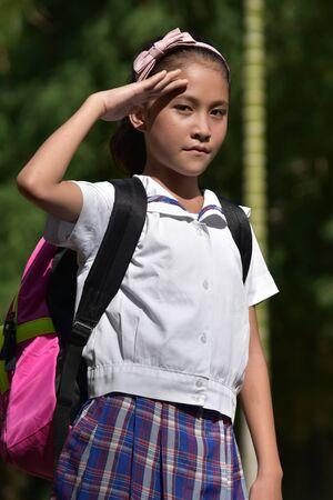 Catholic Diverse Female Student Saluting Wearing Uniform