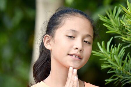 An An Asian Girl Praying