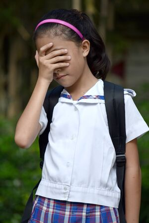 Young Girl Student Under Stress Wearing Uniform 写真素材 - 129902138