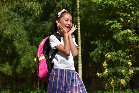 Surprised Catholic Female Student With Notebooks