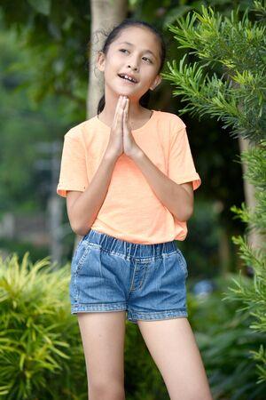 An Asian Teenager Girl Praying