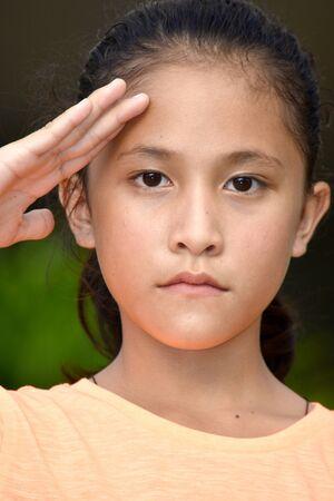 A Youthful Filipina Female Saluting