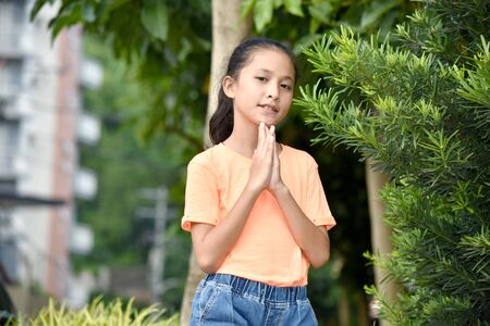 A Young Diverse Teenage Female Praying 写真素材