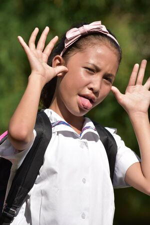 Young Asian School Girl Making Funny Faces
