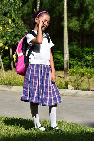 A Tearful Girl Student With Notebooks