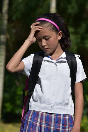 Young Filipina School Girl And Anxiety