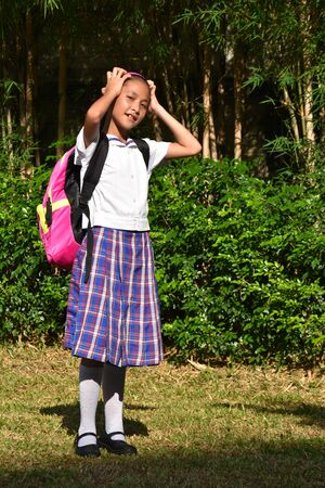 Catholic Filipina Girl Student Memory Problems With Notebooks