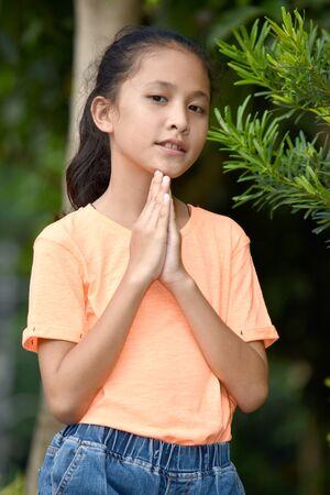 A Pretty Asian Girl Praying