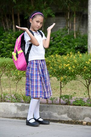 Undecided Diverse Female Student Wearing Uniform With Notebooks