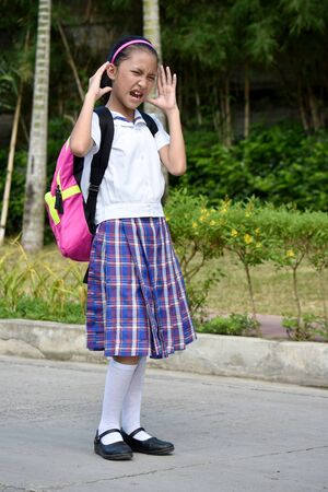 Catholic Asian Girl Student Under Stress With Books 写真素材 - 129903618