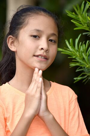 An A Young Female Praying