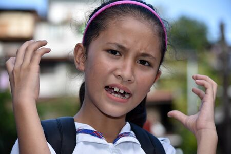 A Beautiful Girl Student Under Stress 写真素材 - 129903746