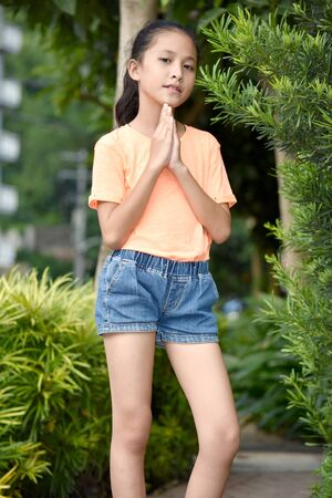 A Youthful Filipina Teenager Girl Praying
