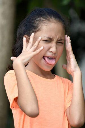 A Cute Filipina Girl Under Stress 写真素材