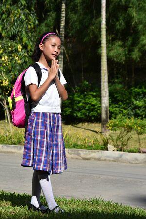 Catholic Girl Student Praying Wearing School Uniform