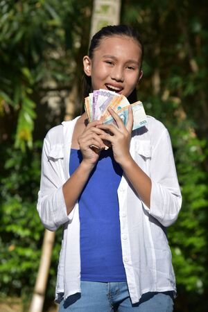 A Youthful Minority Girl With Money