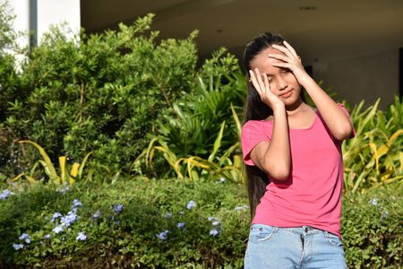 A Youthful Diverse Female Under Stress 写真素材 - 129904769