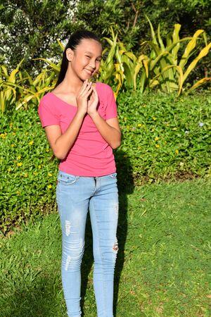 A Beautiful Asian Teen Girl Praying 写真素材
