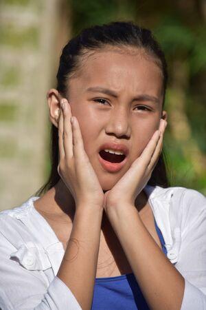 A Startled Pretty Asian Teenage Female