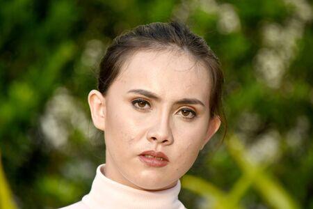 An Unemotional Youthful Female Woman Stock Photo