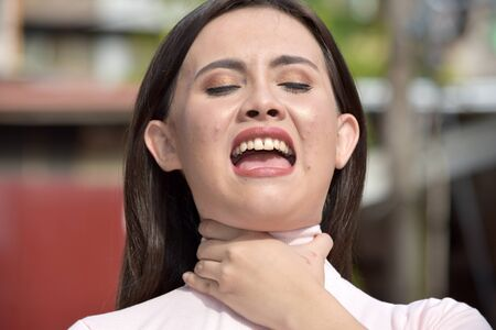 A Diverse Female With Sore Throat Banco de Imagens