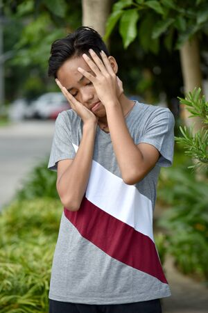 A Filipino Boy Under Stress 写真素材 - 129905453