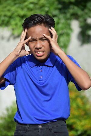A Filipino Teenage Male Under Stress 写真素材