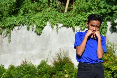 An An Unhappy Teenager Boy Stock Photo