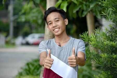 A Teenage Male With Thumbs Up