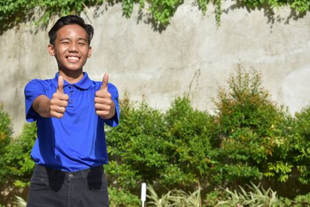 A Teen Boy With Thumbs Up