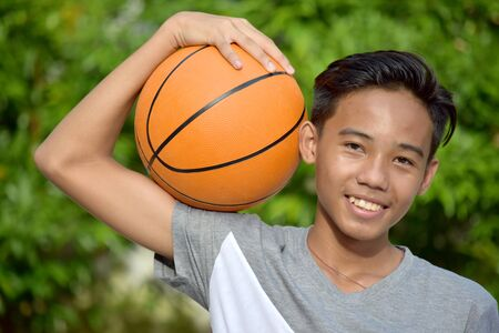 Youth Asian Male Basketball Player And Happiness With Basketball