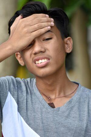 A Diverse Juvenile With Headache Stock Photo
