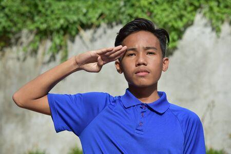 An An Asian Boy Saluting